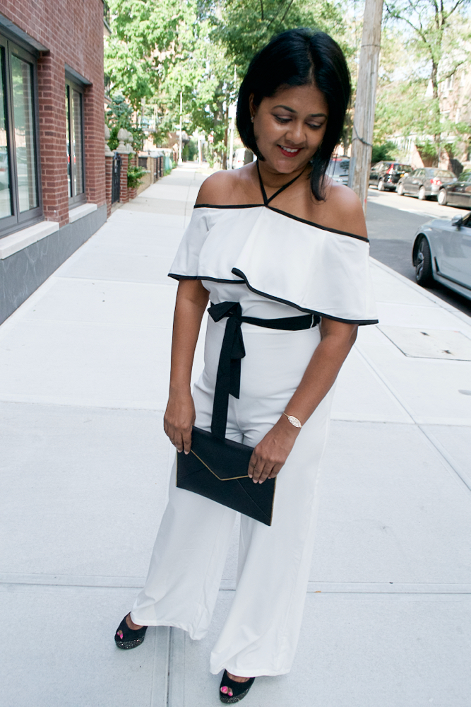 Rebecca MInkoff clutch and white jumpsuit white party outfit